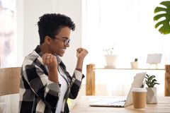 Excited woman feels happy sitting at the desk indoors stock photos