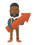 Happy black guy holding arrow up sign Royalty Free Stock Image