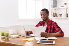 Happy black happy businessman in office, work with laptop Stock Photo