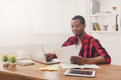 Happy black happy businessman in office, work with laptop Stock Photography