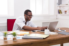 Happy black happy businessman in office, work with laptop Stock Image