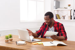 Happy black happy businessman in office, work with laptop Royalty Free Stock Image