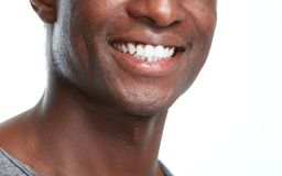 Happy black man smile. Happy african american man smiling face isolated white background stock image