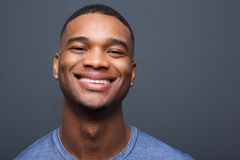 Happy black man smiling on gray background Stock Photos