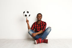 Happy black man spinning ball on his finger Stock Photography