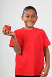 Happy black school boy 9 holding red apple Royalty Free Stock Photos