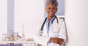 Happy Black Senior doctor smiling at camera stock photo