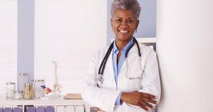 Happy Black Senior doctor smiling at camera Stock Photo