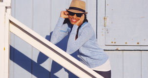 Free Happy Black Woman Leaning On Wooden Rail Royalty Free Stock Photos - 47558758