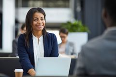Happy black woman meeting with business partner royalty free stock images