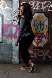 Happy Black Woman Posing at Wall with Vandals Royalty Free Stock Photography