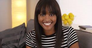 Happy black woman smiling at camera Stock Photo
