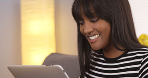 Happy black woman using tablet Royalty Free Stock Photo