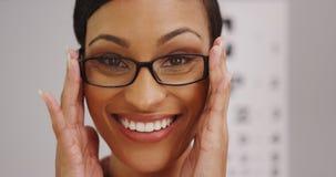 Happy black woman wearing eyeglasses Stock Images