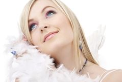 Happy blond angel girl with feather boa stock image