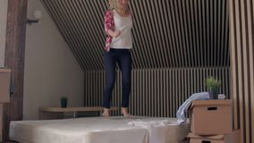 Happy Blond Beautiful Woman jumping On A Bed stock video