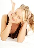 Happy blond in bed Royalty Free Stock Image