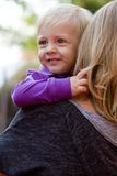 Happy blond boy with his mom outdoors Royalty Free Stock Photography