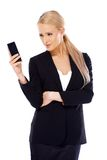 Happy blond business woman using her mobile. Phone on white background Royalty Free Stock Photography