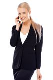 Happy blond business woman using her mobile. Phone on white background Royalty Free Stock Photos
