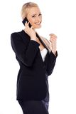 Happy blond business woman using her mobile. Phone on white background Stock Image