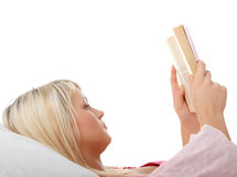 Happy blond caucasian woman reading book Stock Images