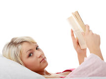 Happy blond caucasian woman reading book Stock Photos