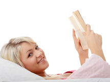 Happy blond caucasian woman reading book Royalty Free Stock Images