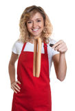 Happy blond clerk with sausages Stock Images