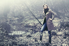 Happy blond fashion woman in classic coat walking outdoor Royalty Free Stock Photo
