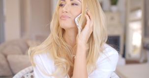 Happy Blond Female Calling at Phone Looking Left Royalty Free Stock Photo