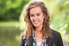 Happy blond female smiling Royalty Free Stock Photos