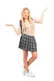 Happy blond female student with raised hands. Full length portrait of a happy blond female student with raised hands  on white background Stock Photo