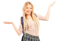 Happy blond female student with raised hands. Isolated on white background Royalty Free Stock Photos