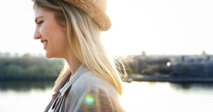 Happy blond female wearing hat outdoor stock images