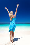 Happy blond girl on beach, feeling freedom. Royalty Free Stock Photography