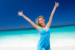 Happy blond girl on beach, feeling freedom. Stock Photography