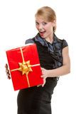 Happy blond girl with red christmas gift box golden ribbon. Holiday. Royalty Free Stock Photos