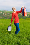 Happy blond Girl With Shopping Bags Stock Photography