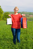 Happy blond Girl With Shopping Bags Stock Images