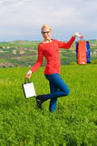 Happy blond Girl With Shopping Bags Royalty Free Stock Photo