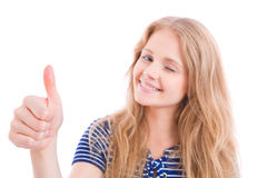 Happy blond girl showing OK - thumb up. Beautiful, happy blond girl showing OK - thumb up - with one hand, sharpness on hand, isolated Royalty Free Stock Photos