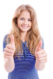 Happy blond girl showing OK - thumbs up. Beautiful, happy blond girl showing OK - thumbs up - with both hands - sharpness on thumbs,  isolated Stock Image