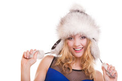 Happy blond girl in warm fur hat. Winter clothes. Fashion and beauty. Royalty Free Stock Images