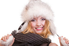 Happy blond girl in warm fur hat. Winter clothes. Fashion and beauty. Stock Photography