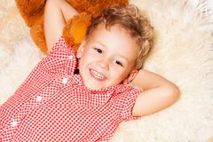 Happy blond kid  on the furs Stock Photo