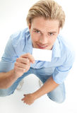 Happy blond man with giving card Stock Photos