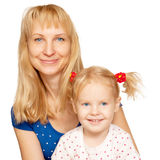 Happy blond mother and daughter faces Royalty Free Stock Image