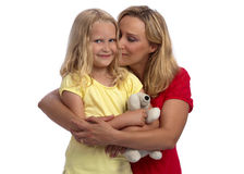 Happy blond mother and daughter hugging Royalty Free Stock Photo