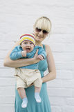 Happy blond mother holding  her baby Royalty Free Stock Image